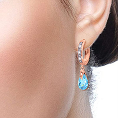 Diamond and Blue Topaz Droplet Huggie Earrings in 9ct Rose Gold