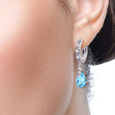Diamond and Blue Topaz Droplet Huggie Earrings in 9ct White Gold